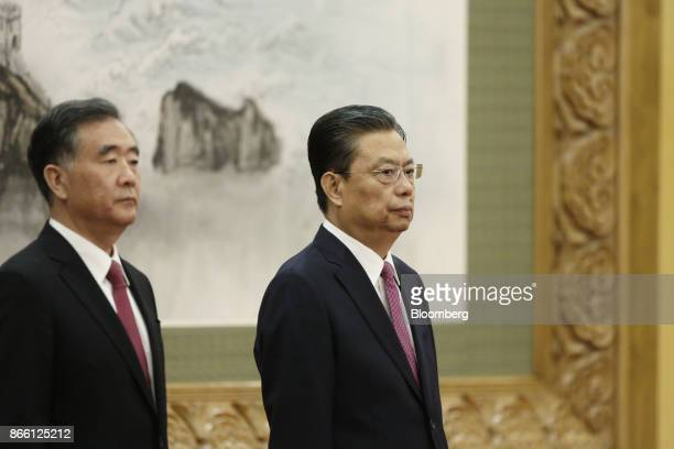 Zhao Leji member of the Communist Party of China's new Politburo Standing Committee right and fellow member Wang Yang stand on stage during its...