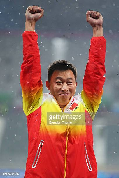 Zhao Qinggang of China celebrates atop the podium after claiming the Gold medal and setting a new Asian and Games record in the Men's Javelin Throw...