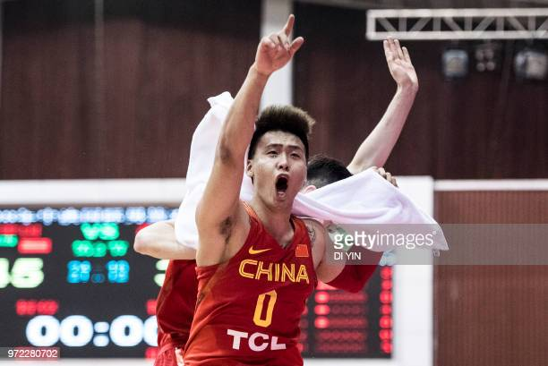 Zhao Rui of China celebrates with teammate during the 2018 SinoAustralian Men's Internationl Basketball Challenge match between the Chinese National...
