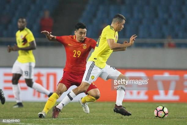 Zhao Xuri of China National Team competes for the ball during the international friendly match between China and Columbia at Chongqing Olympic Sports...