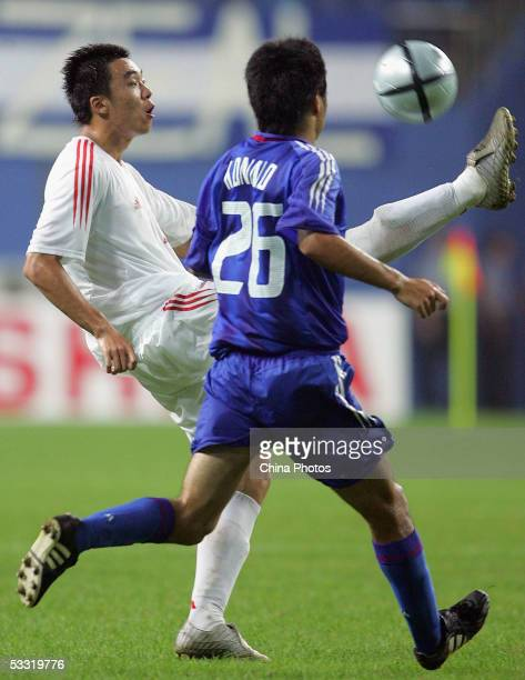 Zhao Xuri of China vies for a ball with Konno Yasuyuki of Japan during a match of the East Asian Football Championship on August 3, 2005 in Daejeon,...