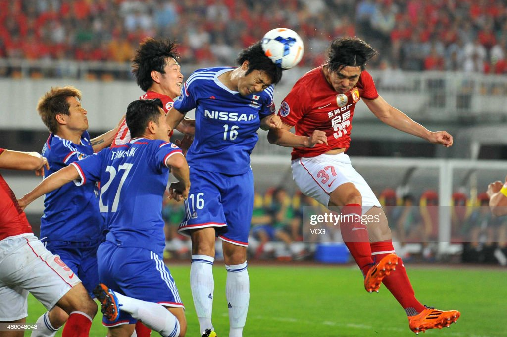Zhao Xuri of(R) Guangzhou Evergrande competes for a ball against Sho Ito of Yokohama F. Marinos during the AFC Asian Champions League match between the Guangzhou Evergrande and Yokohama F. Marinos at Guangzhou Tianhe Stadium on April 22, 2014 in Guangzhou, Guangdong Province of China.