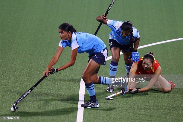 Zhao Yudiao of China competes with Kirandeep Kaur of India in the Women's Pool W at Aoti Hockey Field 1 during day ten of the 16th Asian Games...