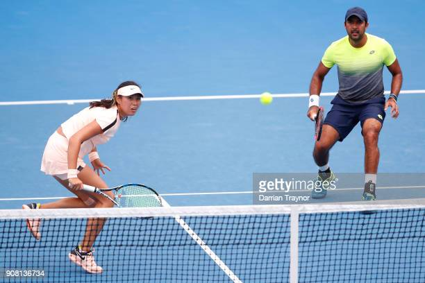 Zhaoxuan Yang of China and AisamUlHaq Qureshi of Pakistan talk tactics in their first round mixed doubles match against HaoChing Chan of Taipei and...