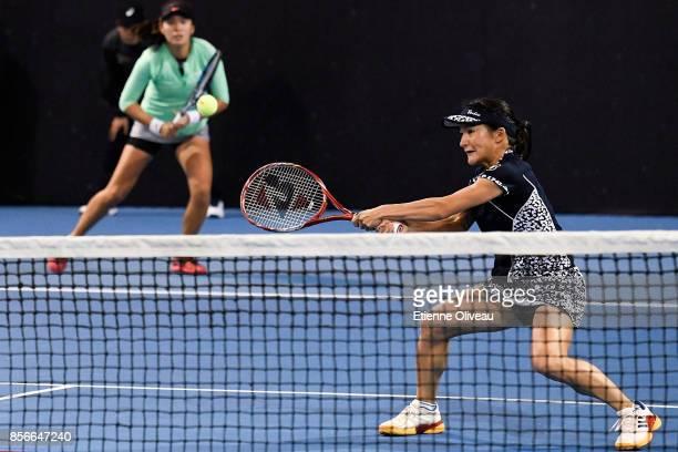 Zhaoxuan Yang of China and Shuko Aoyama of Japan return a shot against Andreja Klepac of Slovenia and Maria Jose Martinez Sanchez of Spain during...