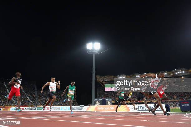 Zharnel Hughes of England crosses the line to win gold ahead of Jereem Richards of Trinidad and Tobago inthe Men's 200 metres final during athletics...