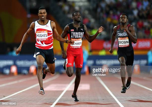 Zharnel Hughes of England Jereem Richards of Trinidad and Tobago and Aaron Brown of Canada compete in the Men's 200 metres final during athletics on...