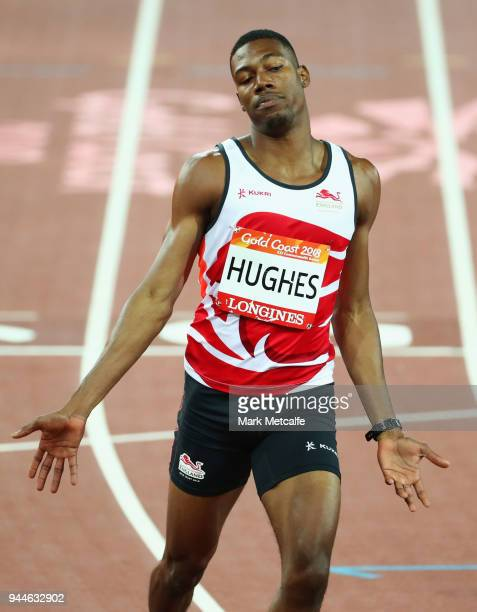 Zharnel Hughes of England reacts as he crosses the line to win his the Men's 200 metres semi finals during athletics on day seven of the Gold Coast...