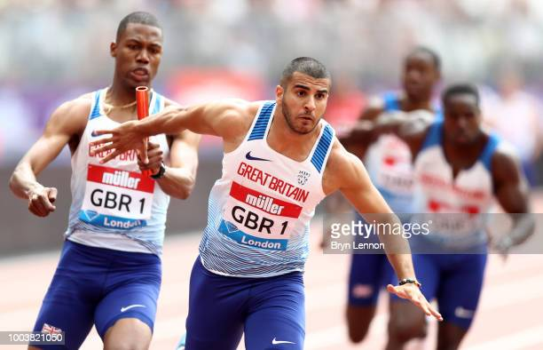 Zharnel Hughes of Great Britain and and Adam Gemili of Great Britain exchange the rod in the 4x100m Men's Relay during Day Two of the Muller...