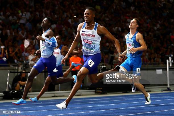 Zharnel Hughes of Great Britain crosses the line to win the Gold medal as Reece Prescod of Great Britain crosses to win the Silver medal in the Men's...