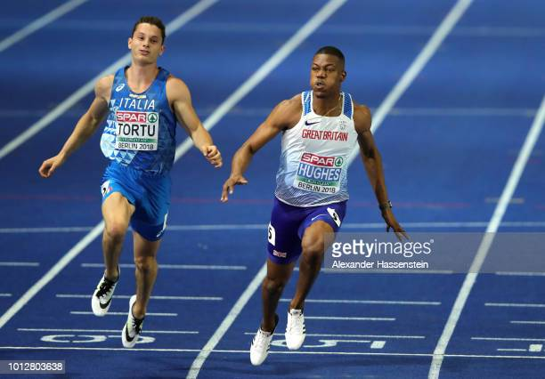 Zharnel Hughes of Great Britain crosses the line to win the Gold medal in the Men's 100 metres final during day one of the 24th European Athletics...