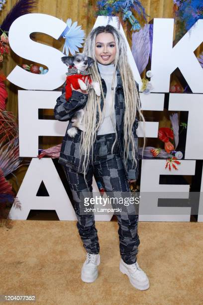 Zhavia Ward and Tinkerbelle the Dog attend the first anniversary celebration of L'Avenue at Saks on February 04 2020 in New York City