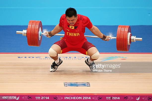 Zhe Yang of China competes in the Men's 105kg Final during day seven of the 2014 Asian Games at Moonlight Festival Garden Weightlifting Venue on...