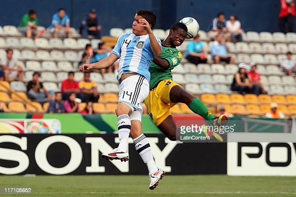 Zhelano Barnes of Jamaica struggles for the ball with Alexis Zarate of Argentina during the FIFA U17 World Cup Mexico 2011 Group B match between...