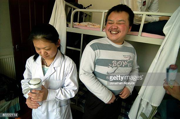 Zhen and her friend, also from Inner Mongolia, are laughing at a joke, on March 12, 2008 in Beijing, China. Most of the blind workers share rooms, as...