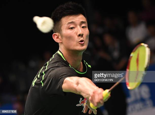 Zhen Long of China returns a shot against Prannoy HS of India during their men's singles quarterfinal match at the Indonesia Open badminton...