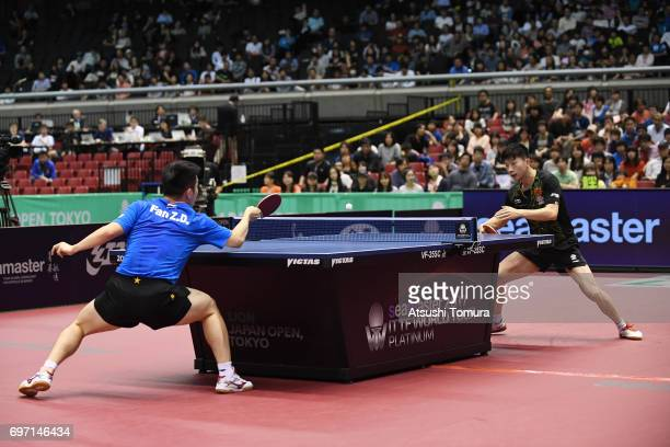 Zhendong Fan of China and Long Ma of China compete in the men's singles final match on the day 5 of the 2017 ITTF World Tour Platinum LION Japan Open...