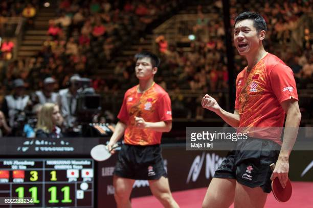 Zhendong Fan of China and Xin Xu of China celebrate after winning Men's Doubles Final at Table Tennis World Championship at at Messe Duesseldorf on...