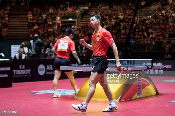 Zhendong Fan of China and Xin Xu of China celebrate during Men's Doubles SemiFinals at Table Tennis World Championship at Messe Duesseldorf on June 3...