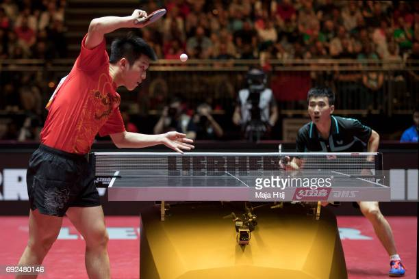 Zhendong Fan of China in action against Sangsu Lee of South Korea during Men's Singles Semifinals at Table Tennis World Championship at Messe...