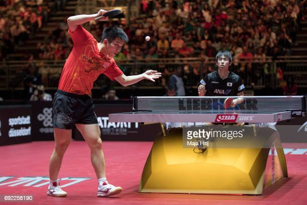 Zhendong Fan of China in action during Men's Singles quarter Final against Koki Niwa of Japan at Table Tennis World Championship at at Messe...