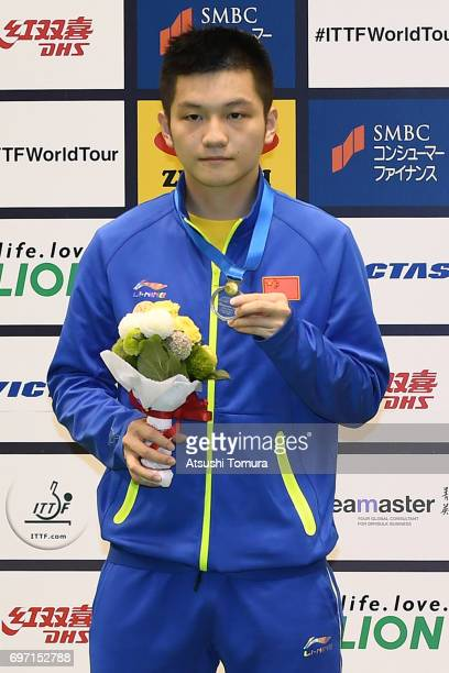 Zhendong Fan of China poses with the silver medal on the podium during the day 5 of the 2017 ITTF World Tour Platinum LION Japan Open at Tokyo...