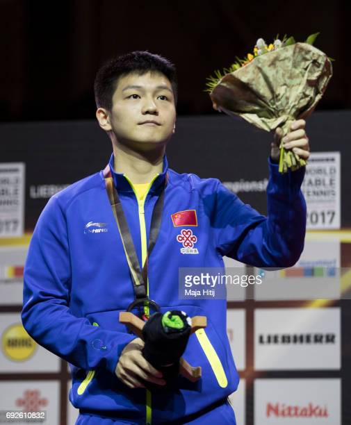 Zhendong Fan of China silver with a bronze medal during celebration ceremony of Men's Singles Final at Table Tennis World Championship at Messe...