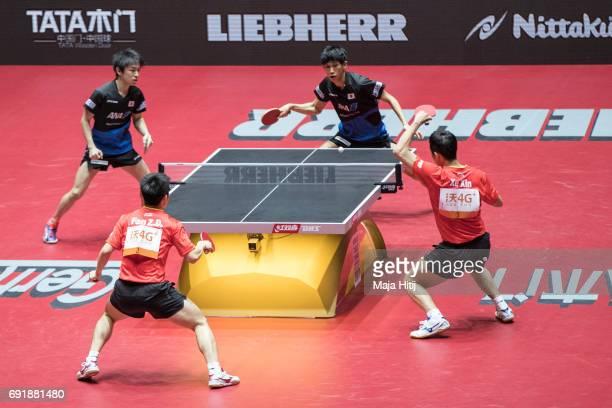 Zhendong Fan of China Xin Xu of China Koki Niwa of Japan and Maharu Yoshimura of Japan in action during Men's Doubles SemiFinals against at Table...