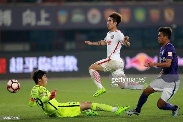 Zheng Dalun of Tianjin Quanjian shoots during the 11th round match of 2017 Chinese Football Association Super League between Tianjin Quanjian and...