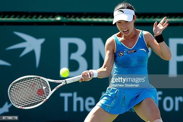 Zheng Jie of China returns a shot to Alicia Molik of Australia during the BNP Paribas Open on March 16, 2010 at the Indian Wells Tennis Garden in...