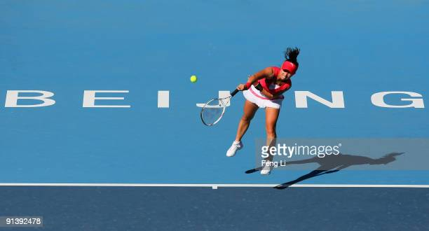 Zheng Jie of China serves against Svetlana Kuznetsova of Russia in her first round match during day three of the 2009 China Open at the National...