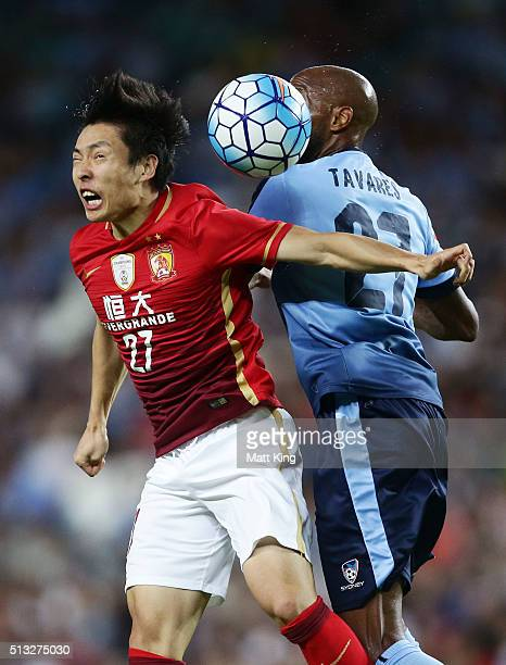 Zheng Long of Guangzhou Evergrande competes for the ball against Mickael Tavares of Sydney FC during the AFC Champions League match between Sydney FC...