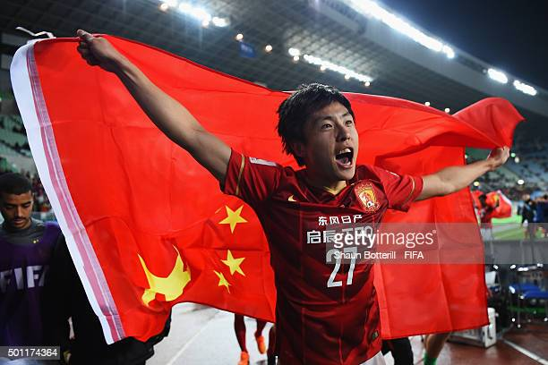 Zheng Long of Guangzhou Evergrande FC celebrates at the end of the FIFA Club World Cup quarter final between the Club America and Guangzhou...