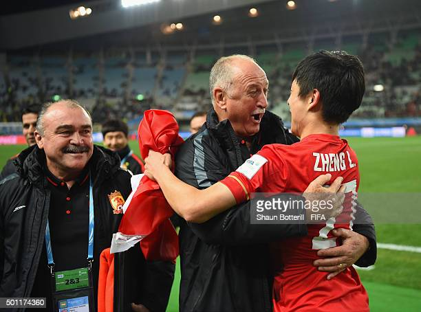 Zheng Long of Guangzhou Evergrande FC celebrates with coach Luiz Felipe Scolari at the end of the FIFA Club World Cup quarter final between the Club...