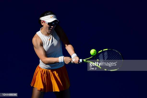 Zheng Saisai of China hits a return against Sloane Stephens of the United States during their Women's Singles 2nd Round match of the 2018 China Open...