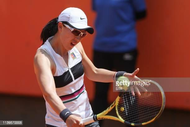 Zheng Saisai of China hits a return during her women's singles semifinal match against Kaylah McPhee of Australia at the Kunming Open tennis...