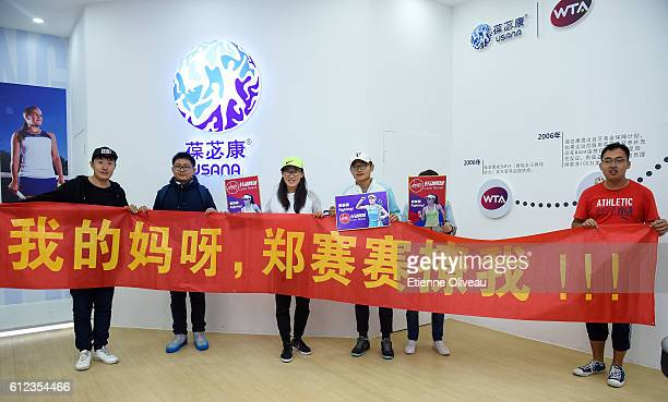 Zheng Saisai of China poses for a photograph with fans at the USANA booth during day four of the 2016 China Open at the China National Tennis Centre...