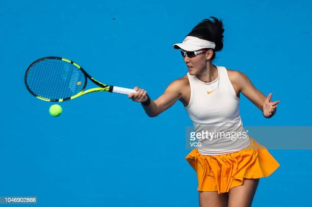 Zheng Saisai of China returns a shot in the Women's Singles first round match against Dayana Yastremska of Ukraine attends a press conference on day...