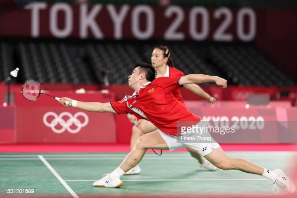 Zheng Si Wei and Huang Ya Qiong of Team China react as they compete against Tang Chun Man and Tse Ying Suet of Team Hong Kong China during a Mixed...