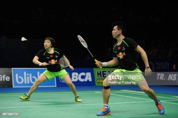 Zheng Siwei and Chen Qingchen of China compete against Tontowi Ahmad and Liliyana Natsir of Indonesia during Mixed Double Final match of the BCA...