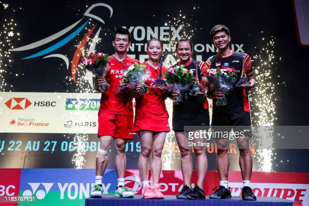 Zheng Siwei and Huang Yaqiong of China and Melati Daeva Oktavianti and Praveen Jordan of Indonesia pose with their trophies after the Mixed Double...