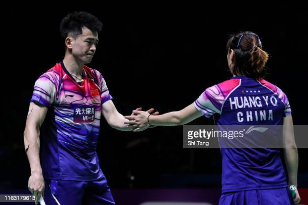 Zheng Siwei and Huang Yaqiong of China celebrate the victory after the Mixed Doubles semi finals match against Tan Kian Meng and Lai Pei Jing of...