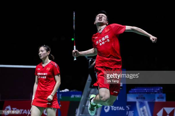 Zheng Siwei and Huang Yaqiong of China celebrate the victory in the Mixeds Double final match against Dechapol Puavaranukroh and Sapsiree...
