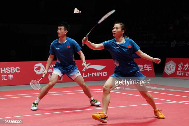 Zheng Siwei and Huang Yaqiong of China compete against Dechapol Puavaranukroh and Sapsiree Taerattanachai of Thailand during their mixed doubles...