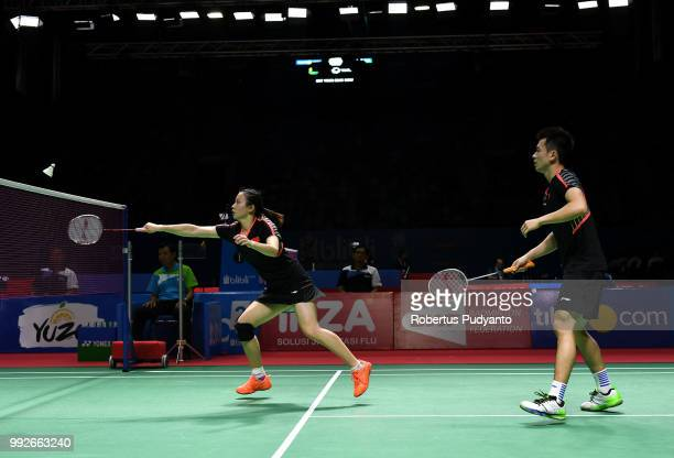 Zheng Siwei and Huang Yaqiong of China compete against Yuta Watanabe and Arisa Higashino of Japan during the Mixed Doubles Quarterfinal match on day...