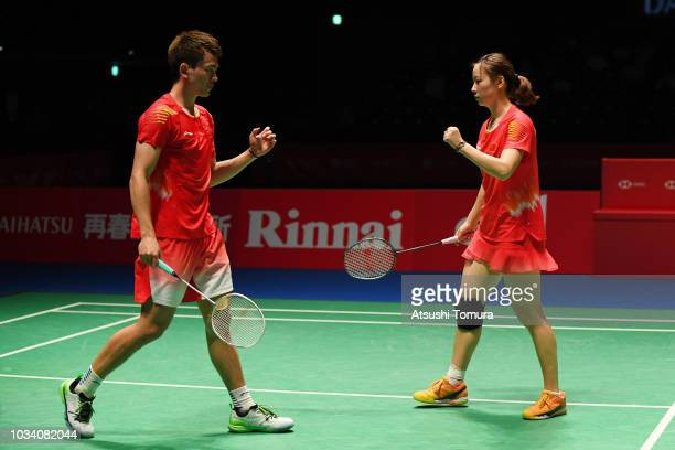 Zheng Siwei and Huang Yaqiong of China compete in the mix doubles final match against Wang Yilyu and Huang Dongping of China on day six of the Yonex...
