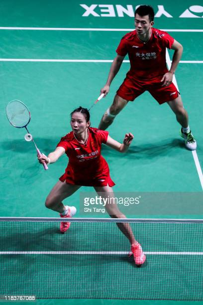 Zheng Siwei and Huang Yaqiong of China compete in the Mixed Double final match against Praveen Jordan and Melati Daeva Oktavianti of Indonesia on day...