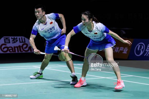 Zheng Siwei and Huang Yaqiong of China compete in the Mixed Double final match against Wang Yilyu and Huang Dongping of China on day six of the...