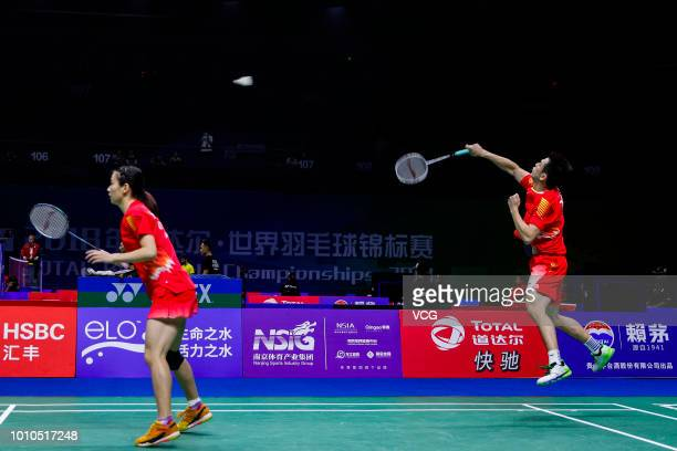 Zheng Siwei and Huang Yaqiong of China compete in the Mixed Doubles second round match against Evgenij Dremin and Evgenia Dimova of Russia on day two...