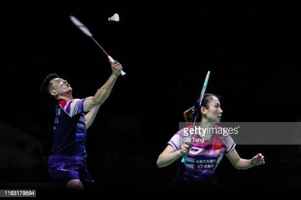 Zheng Siwei and Huang Yaqiong of China compete in the Mixed Doubles semi finals match against Tan Kian Meng and Lai Pei Jing of Malaysia on day five...